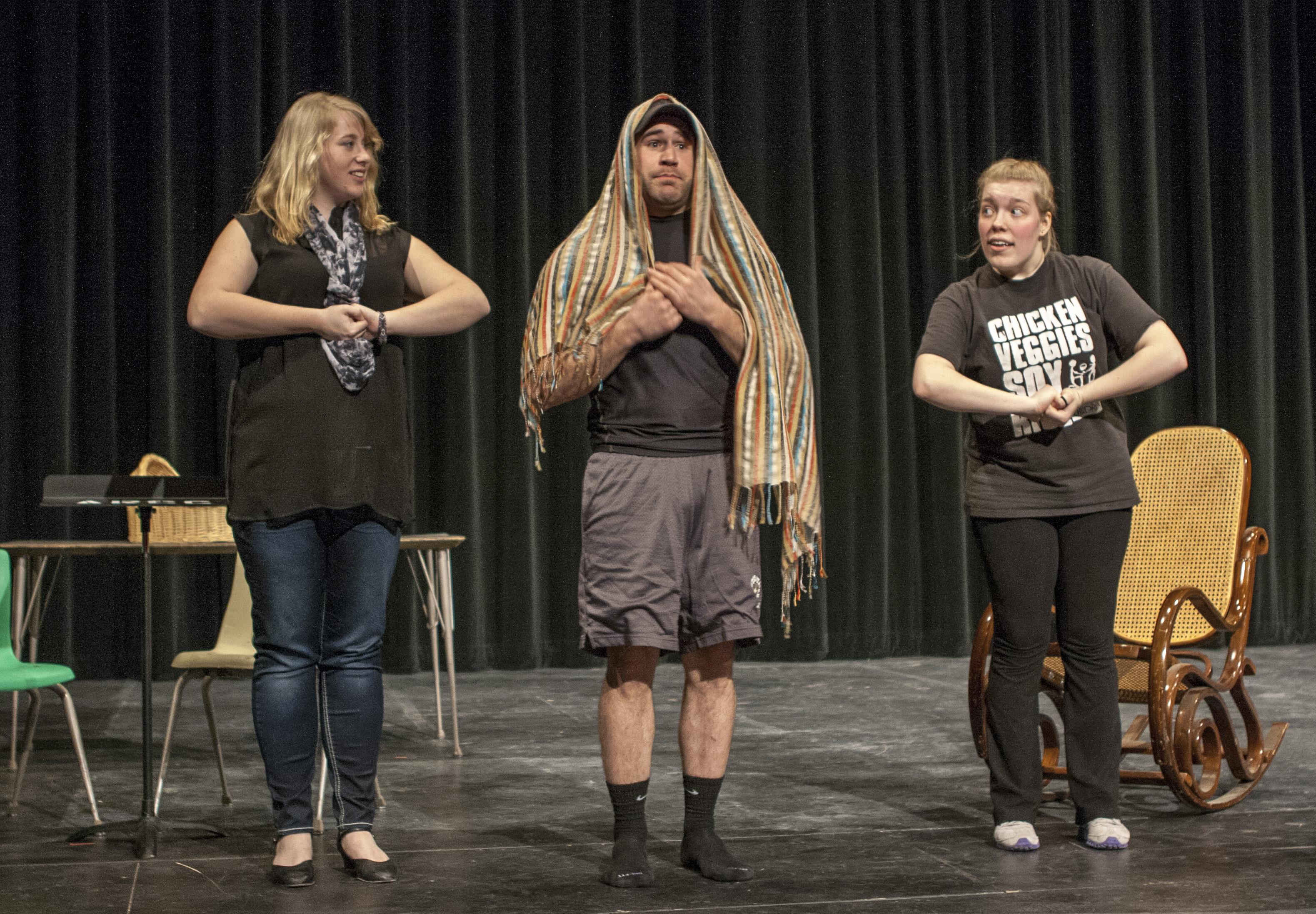 Melanie Bratsch, Jarrod Dukowitz, Emily Picardi rehearsing a scene on March 10. PHOTO BY LAUREN KASTNER