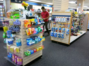 ARCC student shopping in the bookstore on Sept 19th. Along with textbooks the store sells convience sized packages of many medications and toiletries.
