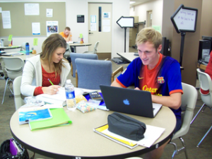 PHOTO BY SAM GENTLE Courtney Hickman and Ryan Steffano working on homework in the Academic Support Center in early September