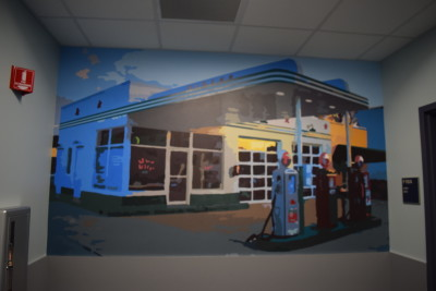 PHOTO BY CASSIE FISKEWOLD The gas station mural up close in the F-Wing at Cambridge