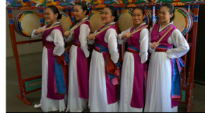 PHOTO COURTESY OF ZDON FAMILY  Zdon is pictured in the middle after a dance performance in 2013 with her Mu Gung Hwa Korean Dance Academy team.