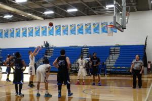 basketball player shoots three pointer