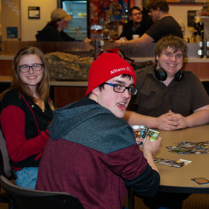 students at table playing Magic the Gathering