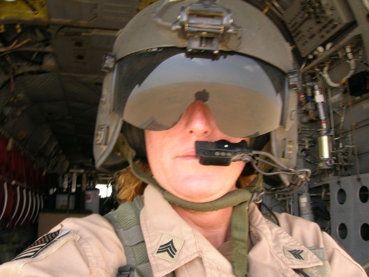 Staff Sergeant Austin in flight gear on a Chinook during Afghanistan tour.