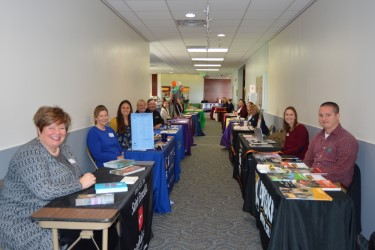 Universities and private colleges filling the hallways of ARCC Cambridge campus. Photo Credit: Maiya Fair