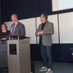Kent Hanson and Tom McCarthy laugh at their own jokes while delivering an informal presentation at award celebration. Photo Credit: Savannah Johnson