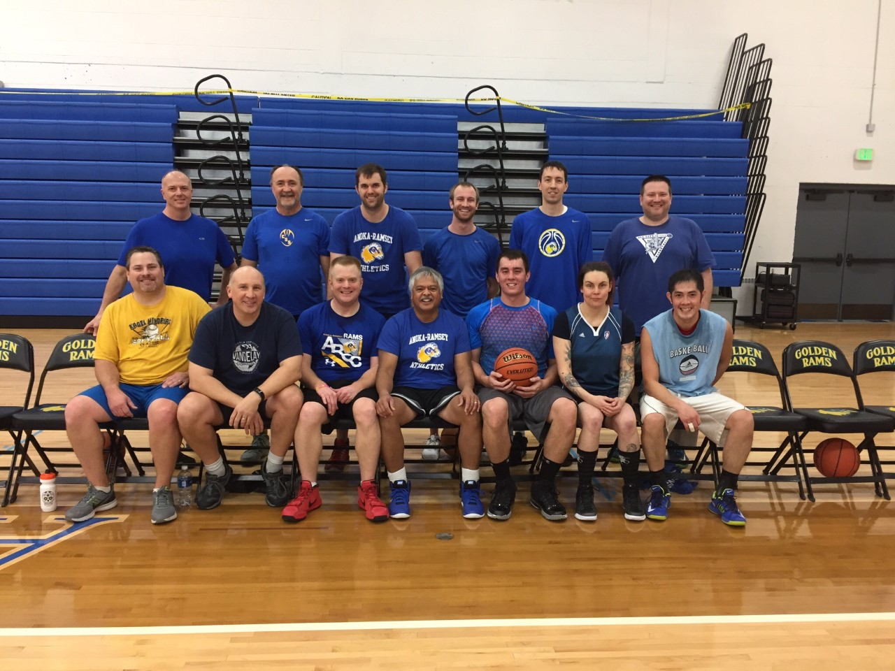 """The winning team poses for a photo after the game. Back row (L to R): John Herbert, Keven Dockter, Aaron Peterson, Michael Buchman, Rory Larson, Jeff Pool Front row (L to R): Bruce Bordwell, Gary Forst, Ryan Olson, Al """"The Hammer"""" Mamaril, Erik Vinh, Melody Hoffmann, Trung Ha"""